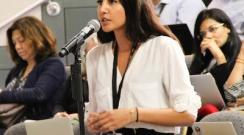woman_at_podium_linc_0.jpeg?itok=9YScseu7